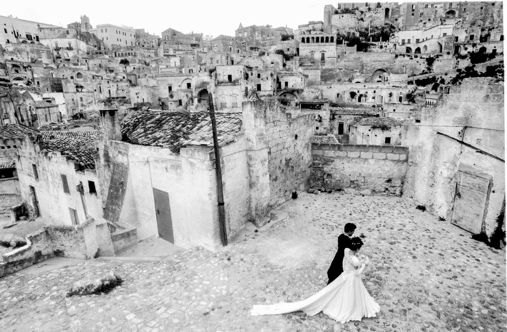 Matera, Italy - 19 October 1991 Immediately after the wedding, it is a local tradition to walk alone along the town streets.