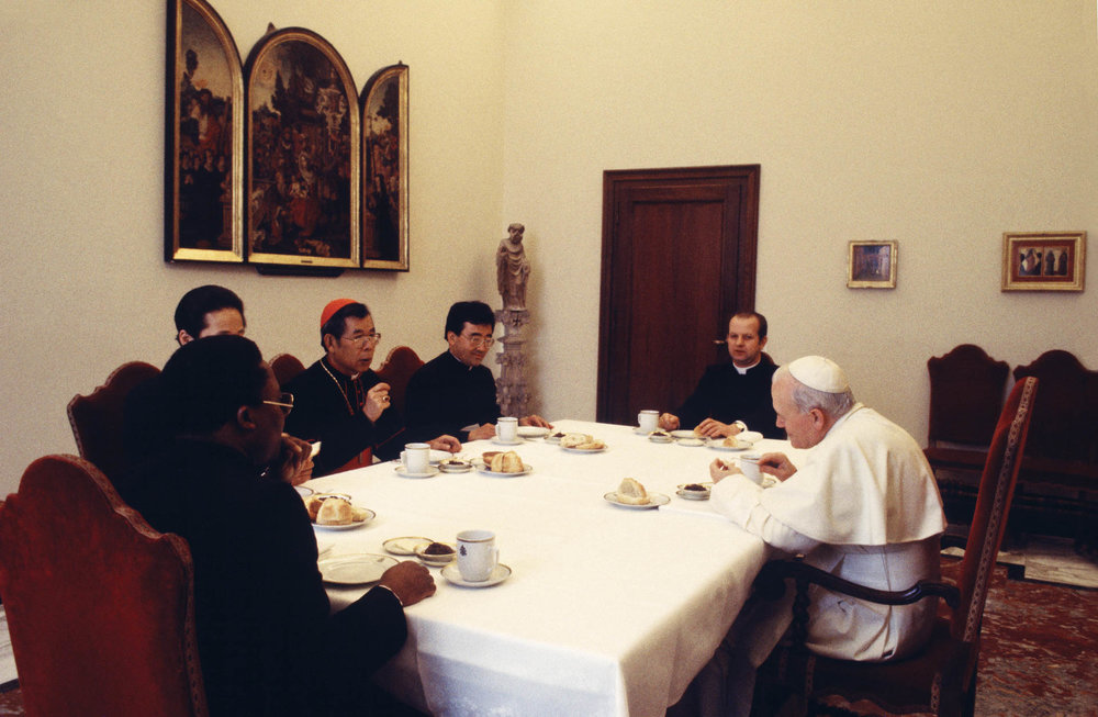 The Vatican - February 1986 A day in the life of the Pope John Paul II in the intimacy of the Vatican: breakfast in the dining room of Palazzo Apostolico with Cardinal Stephen Kim, private secretary Stanislao Dziwisz and his secretary at time Emery Kabongo.