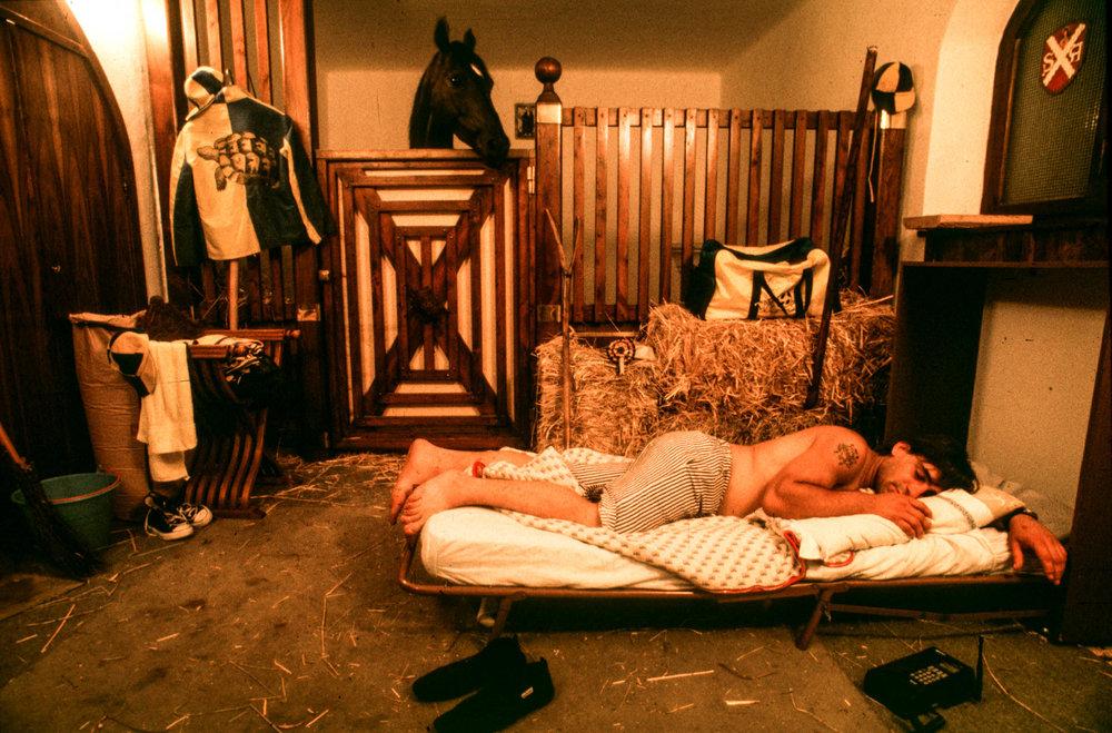 Siena, 1 July 1991 A Tartuca 'contradaiolo' jockey sleeps with his horse the night before the Palio.