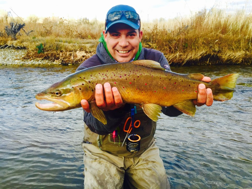 Kennie Garcia  Kennie started his fly fishing career at the age of 7, watching fish in the Kid's Canal one day, as the fish were eating hoppers. He tied a hopper to a hook, caught a fish, and he was hooked from there on. Kennie was the kid who, if there was a creek, river, pond, or puddle, he wanted to find out if there were fish in it. He guided full time for 12 years before starting Salt Lake Fly Fishing Company. Kennie spends around 230 days a year on local waters following fish. In the winter, he is a backcountry snowmobile guide, and the spring and fall he loves chasing fish in saltwater or on the flats. Kennie loves teaching and watching people fall in love with fly fishing. If he's not 'working', you'll find him on a river.