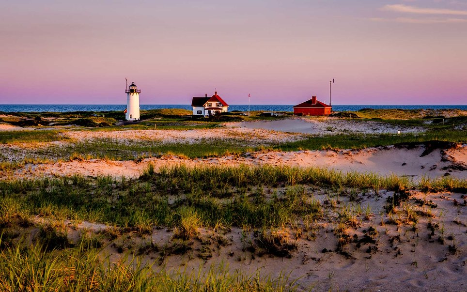 Impossibly white beaches, marshes, and the lighthouses that decorate New England's coast appear in abundance at the Cape Cod National Seashore.