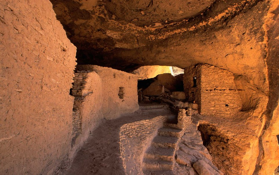 The Gila Cliff Dwellings National Monument contains caves that have been used as shelters by nomadic peoples for thousands of years.