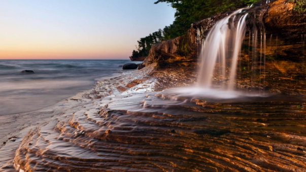 Nestled along Lake Superior's southern shoreline on the Upper Peninsula, this remote park is a geologic wonder of colorful sandstone cliffs topped with stately pines, and miles of quiet, unspoiled beaches strewn with agate, jasper, and quartz.