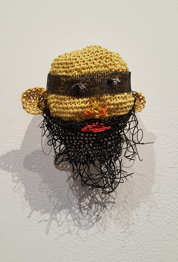 Merran Sierakowski, Who is that masked emoji?, 2016, computer data cable and mesh.