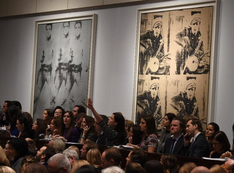 Andy Warhol's  Triple Elvis  and  Four Marlons  on display during the Christie's Post War and Contemporary art evening sale on November 12, 2014