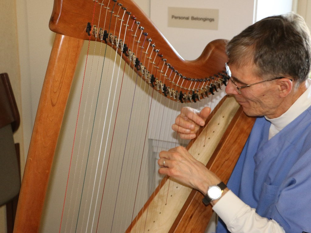 Playing the Celtic Harp in a patient room at a St. Paul hospital.