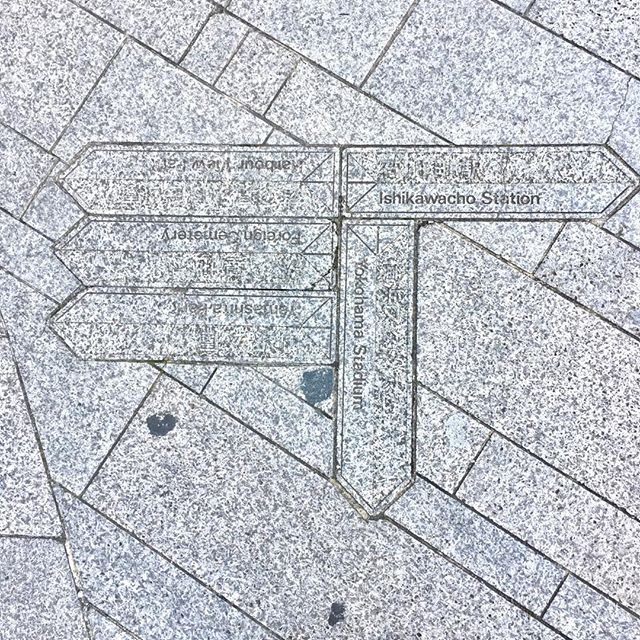 #Wayfinding engraved into the granite pavement of the sidewalk.