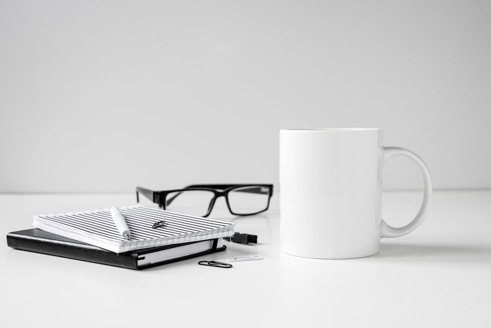 """Figure 1.  From """"Black and white coffee mug mock up with notebooks, pen and glasses on work desk,"""" by Sigridstock, n.d., https://www.shutterstock.com/image-photo/black-white-coffee-mug-mock-notebooks-724222396/ . Copyright 2018 by Sigridstock."""