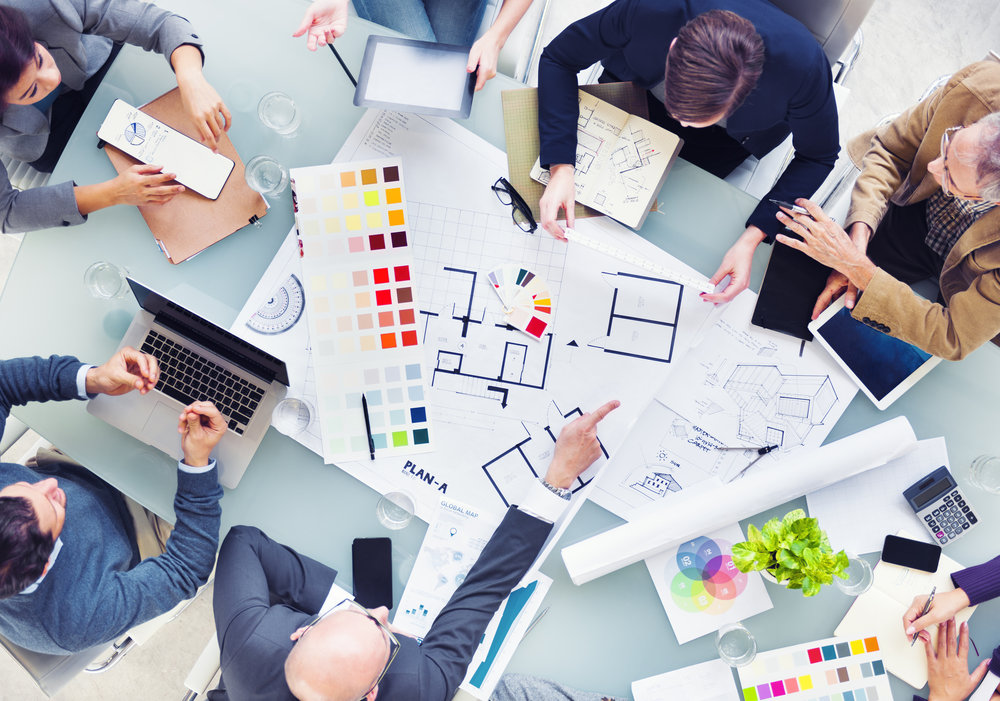 """Figure 3.  From """"Design Team Planning for a New Project,"""" by Rawpixel.com, n.d.,  https://www.shutterstock.com/image-photo/design-team-planning-new-project-189590255/ . Copyright 2018 by Rawpixel.com."""