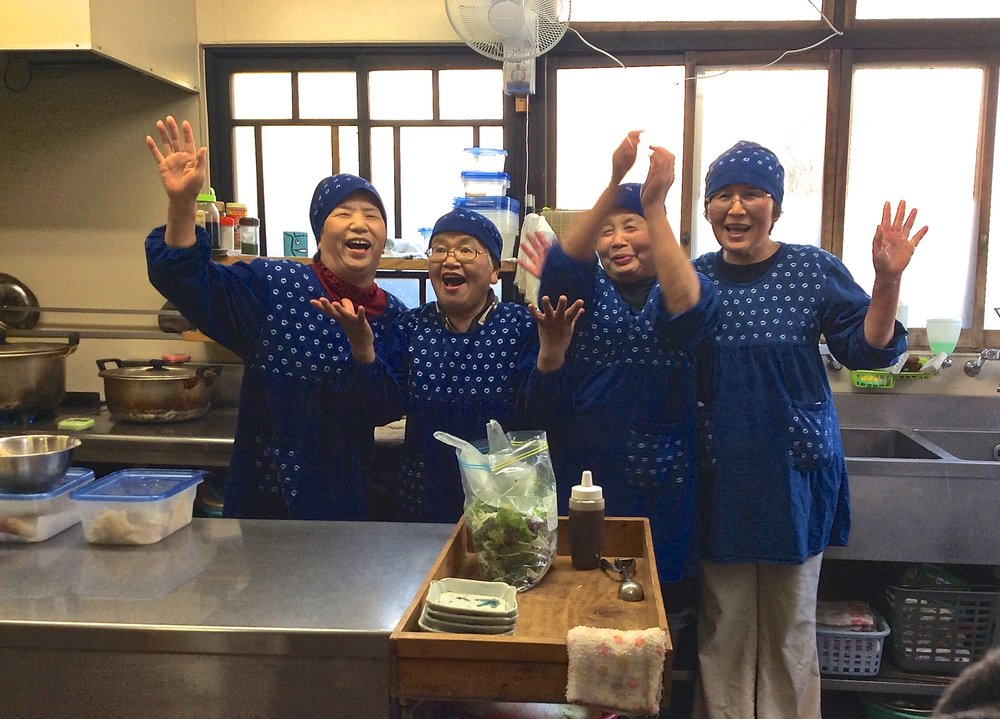Mrs. Nishino, second from left, in the kitchen with her friends.