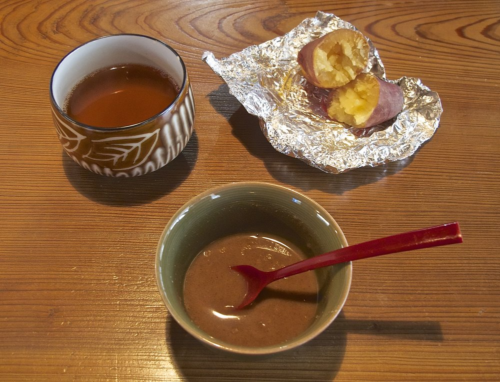 Hattaiko  is a porridge made by mixing roasted barley flour with sugar and hot water. Served with a roasted satsuma potato and  hoji-cha , or roasted green tea, it's a welcome snack on a cold winter's day.