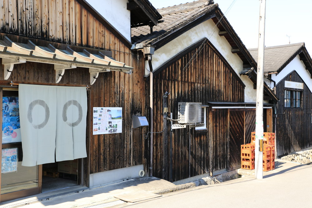 Katakami Soy Sauce makes one, two, and three-year aged soy sauce in traditional wooden barrels. The Katakami family offers regular soy sauce making demonstrations and workshops.
