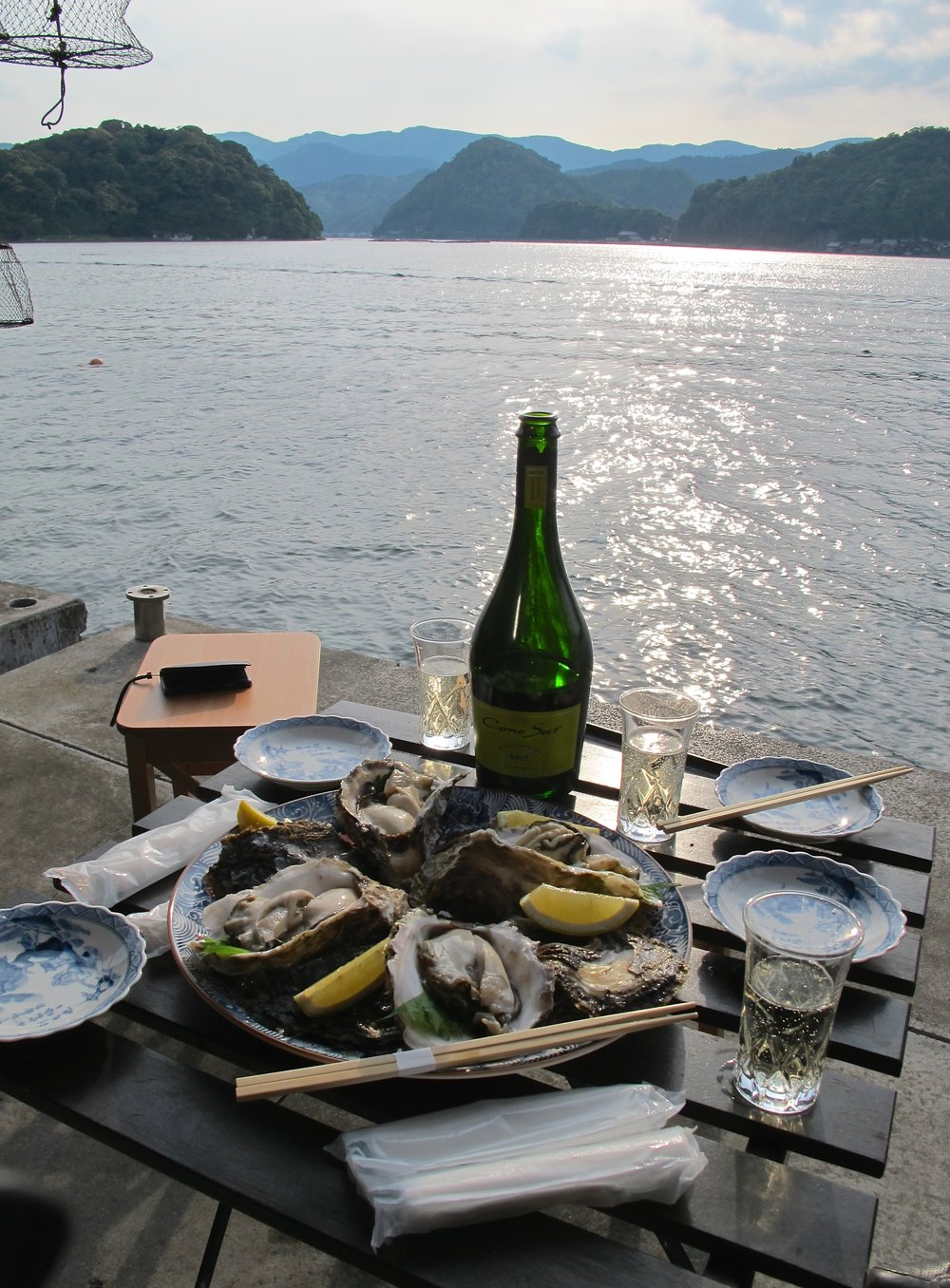 Sunset at Kuraya guesthouse accompanied by champagne and rock oysters (iwagaki.)