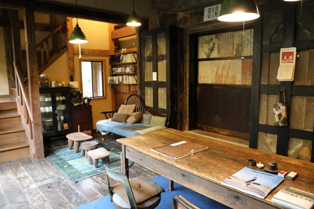 The eclectic yet tranquil study looks out onto a small courtyard garden.