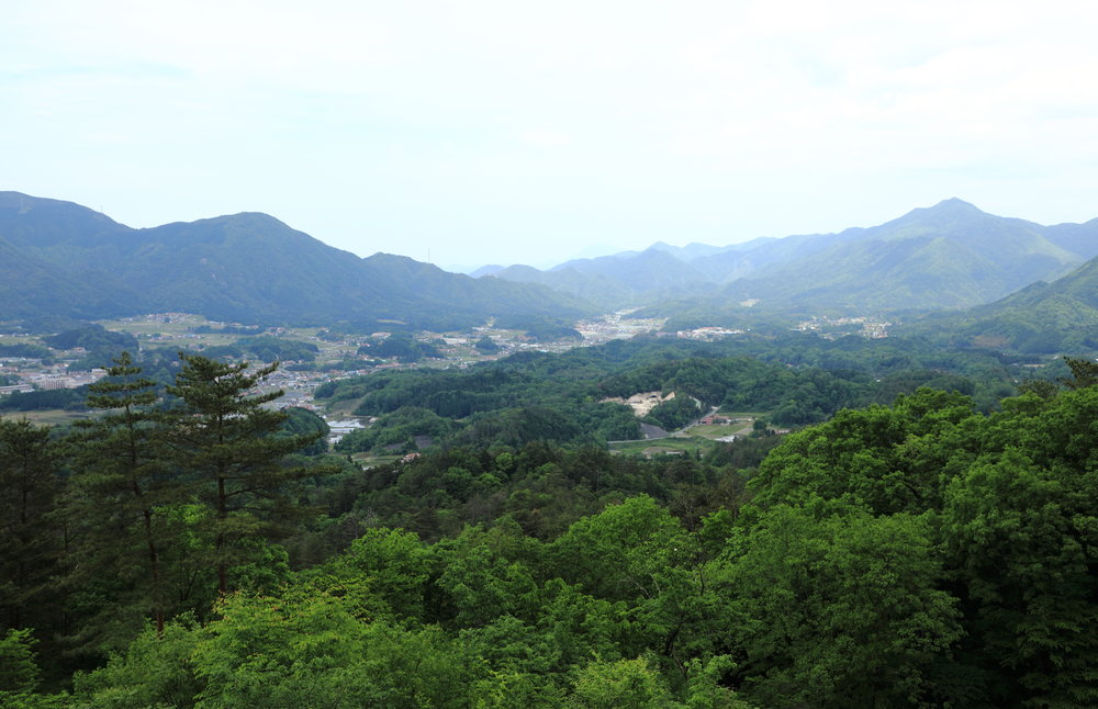 The lush, high mountain farming community of Onan in its protected basin as seen from the surrounding hills.