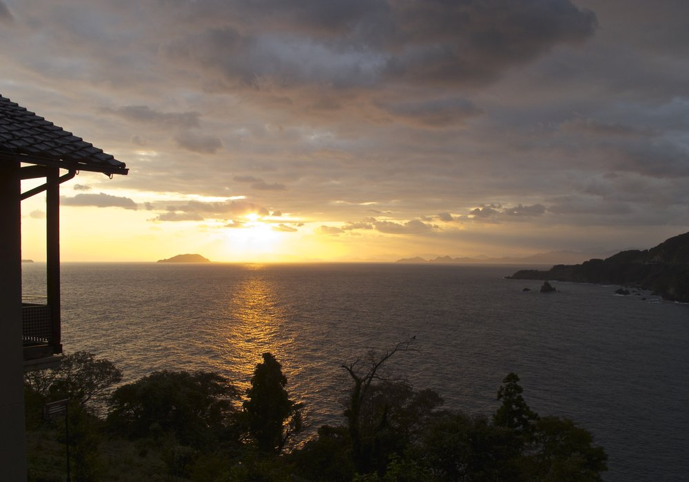 The winding, twisting coastline of the Tango Peninsula offers both spectacular sunsets and sunrises like this sunrise seen from a room at Okuine Onsen Aburaya Honkan, a large ryokan perched on a cliff about ten minutes south of Ine by car.