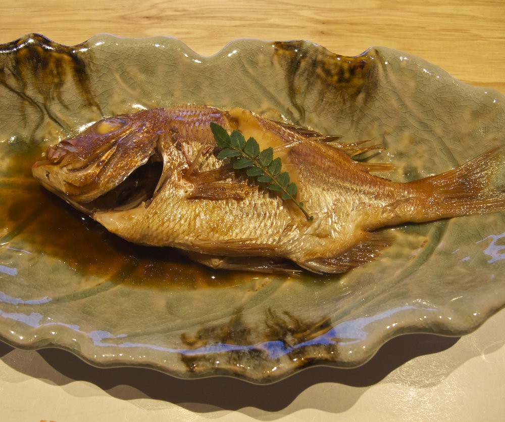 A prized  nodoguro , or blackthroat seaperch, prepared  nitsuke  style, which means the fish has been braised in a sweet, salty, gingery, umami-rich broth to complement the rich yet tender flake of the fish.