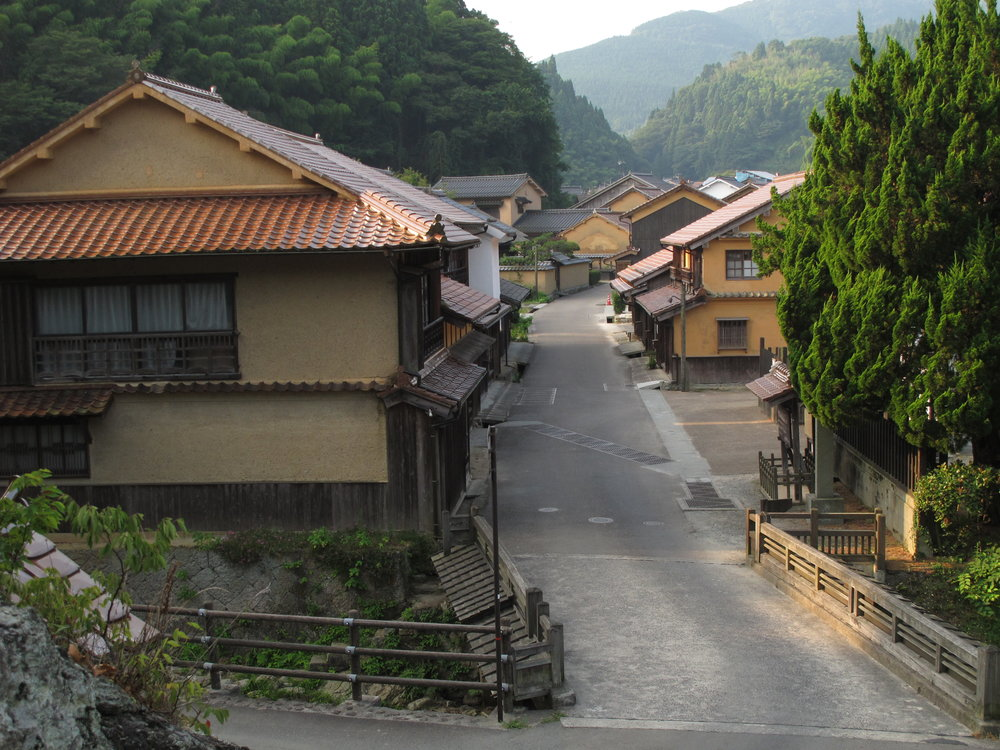 Omori is essentially one long road of traditional homes, shops, cafes, shrines, and temples that parallels the course of a rocky stream winding through the folds of the deeply-forested mountains of central Shimane prefecture.