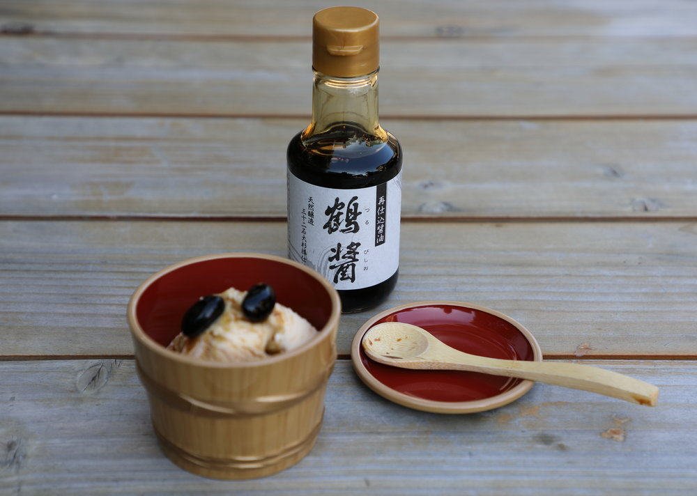 "Custard ice cream topped with Yamaroku's ""Tsuru-bishio"" four year-aged soy sauce and large, sweet black soy beans ."
