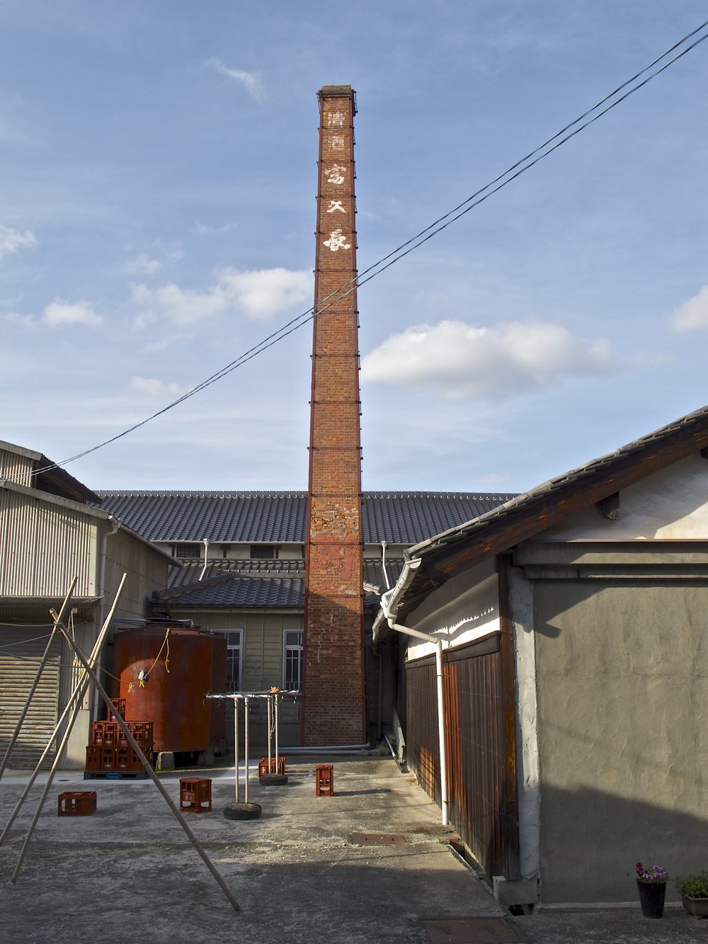 Imada Shuzo's red brick chimney is typical of sake breweries built in the Meiji era (1868-1912).