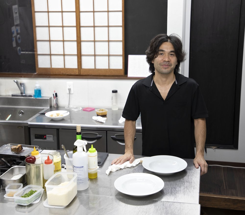 Chef Yasuhiko Shige in the kitchen at Aceto.