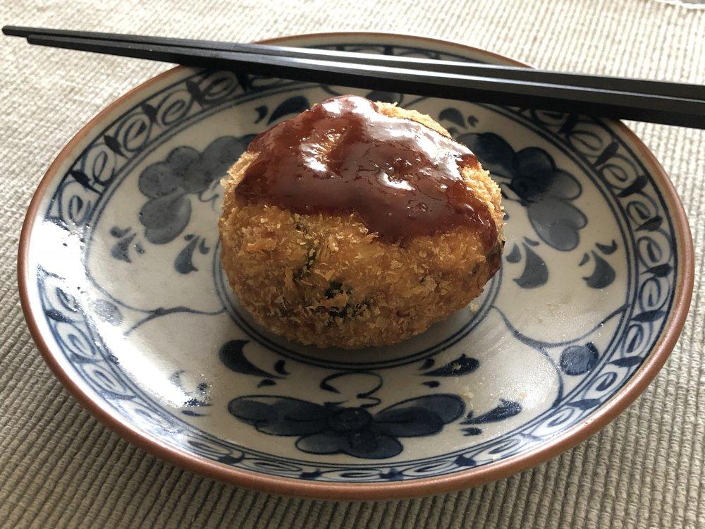 Torii's  chuno so-su  gracing a  korokke  potato croquette.