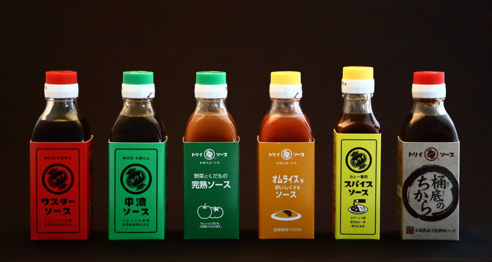 The Torii family of sauces. The red-labeled bottle on the left is Torii's  usta so-su.  Proceeding to the right are:  chuno so-su ,  kanjuku so-su ,  ome-rice so-su ,  spice so-su , and  okedoko no chikara so-su .