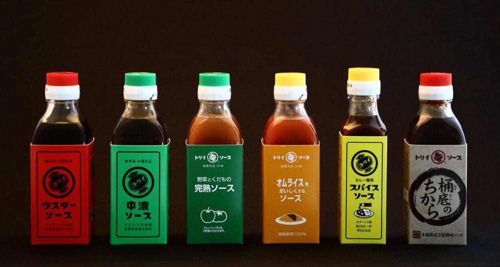 The Torii family of sauces. The red-labeled bottle on the left is Torii's  usta so-su.  Proceeding to the right are:  chuno so-su ,  kanjuku so-su ,  ome-rice so-su ,  spice so-su , and  okedoko no chikara so-su .