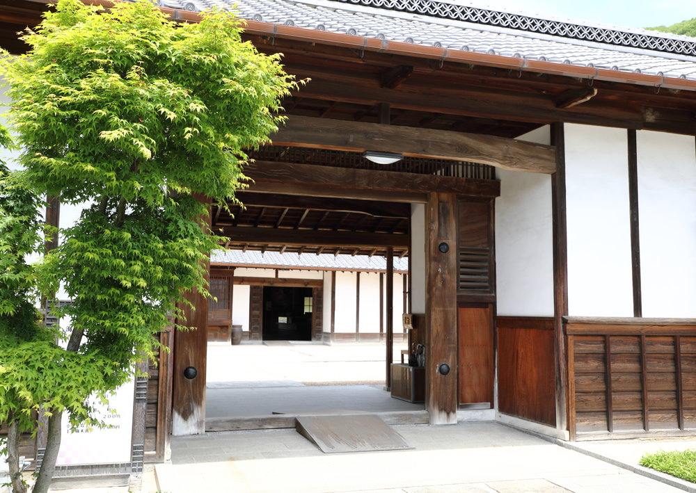 The massive entrance gate to the Mochizuki family compound.