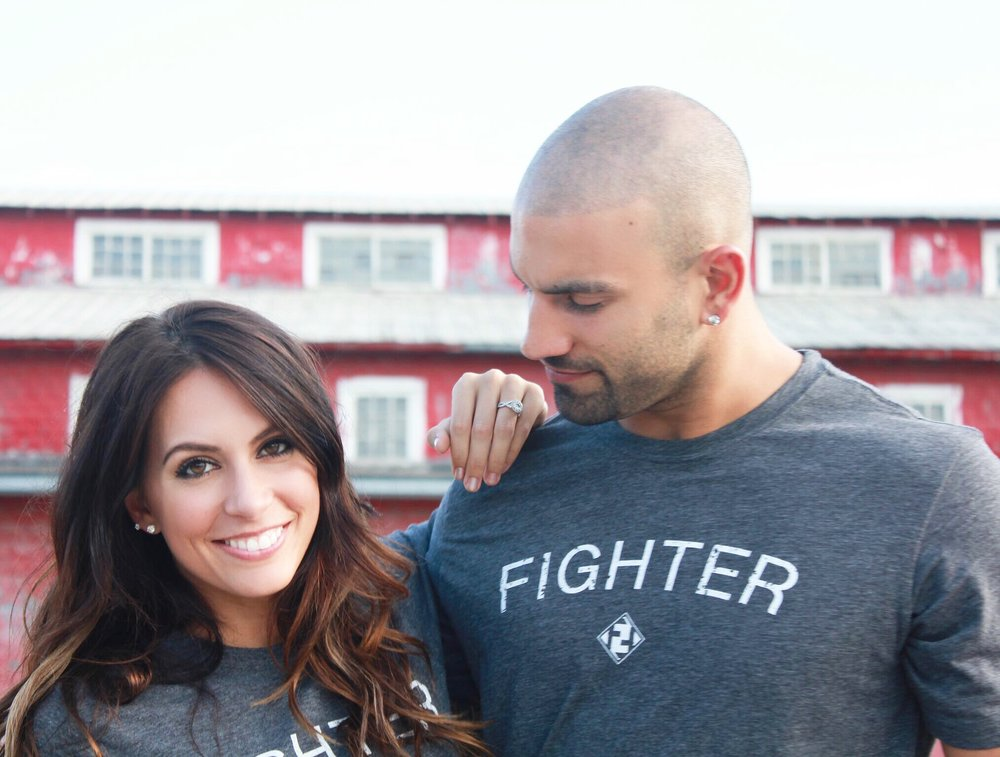 "CREATED BY HUSBAND & WIFE - PROFESSIONAL BOXER, JOSH ""HANDSOME HITMAN"" HIMES AND HIS WIFE, SINGER/SONGWRITER BRYNN MARIE, TEAMED UP TO COMBINE BOXING AND MUSIC TO GIVE EVERYDAY FIGHTERS THE OPPORTUNITY TO INCITE A POSITIVE CHANGE IN THE MIND, BODY & SOUL."