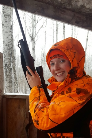 My husband is also an avid hunter...this photo was taken right after he asked me to marry him in the deer stand!