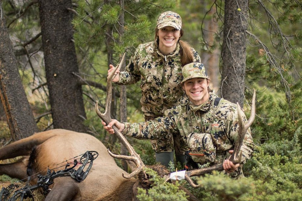 Cara Harper with her husband Grant and his 2018 DIY archery elk on public land. In the episode, Cara explains how she called in this elk so Grant could get a shot.