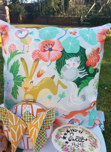 'Spring' Cushion by Rollerdog, currently reduced to £13.