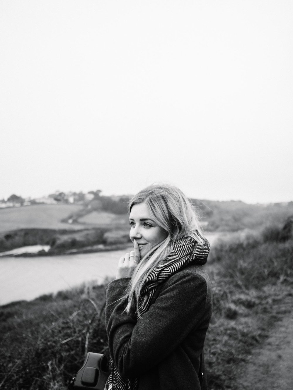 "Here is Anna, once again, only this time, this image has been used for her web design business,  ByRosanna . The branding for ByRosanna is very different to that of The Cornish Life - it's much darker, more modern and slightly moody. These headshots of Anna were taken on a walk during Winter. By converting the images into black and white, the vibe was taken from being a bit too ""lifestyle"" for her brand, to much more formal, whilst still keeping the friendly, relaxed vibe that Anna maintains throughout her business!"
