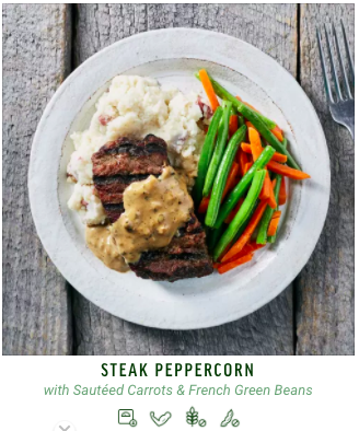 Add a touch of gourmet to your steak dinner with this dish. Tender grilled steak sits on a bed of fluffy potato mash and is topped in a delectable peppercorn cream sauce. Served with a side of sautéed carrots, french green beans and roasted garlic.
