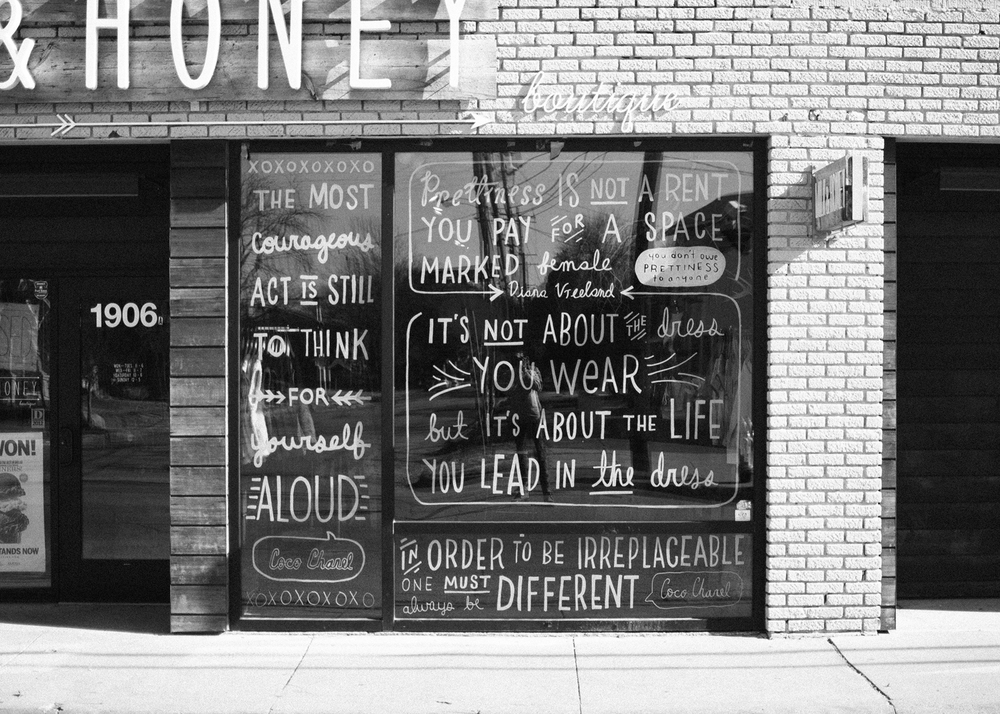 Kyle's hand-drawn words on the storefront of  Milk & Honey  boutique in Dallas.
