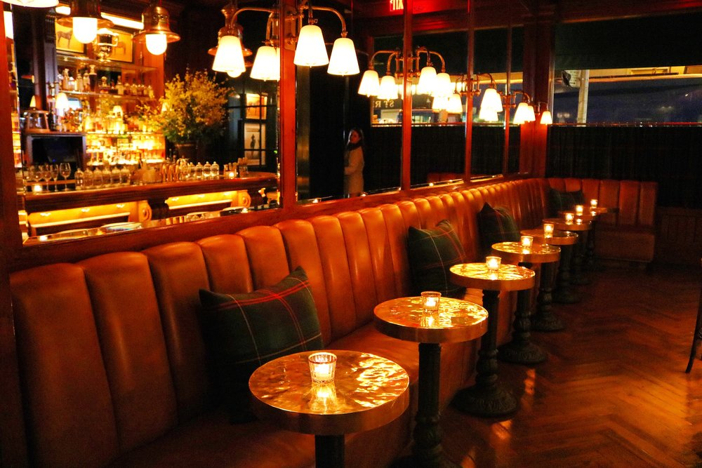 RL Signature Tartan Pillows Compliment The Leather Seating And Hammered  Copper Tables In The Bar Area
