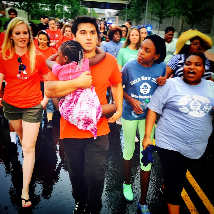 RePublic's Ravi Gupta and Abigail Rockey march alongside families from Liberty Collegiate Academy.