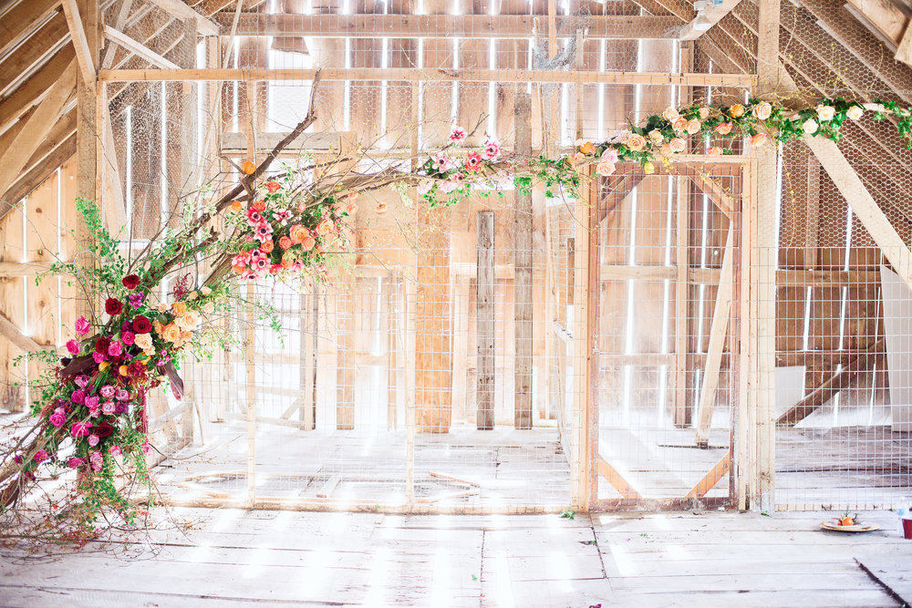 Installation created by TEXTURE Florals, Layers of Lovely and Wildflowers by Design / Photo: Delaney Dobson Photography