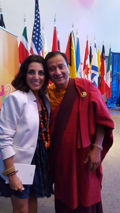 Silvia Garcia with a member of  Bhutan , the first country to measure their progress using Gross Happiness Product instead of GDP