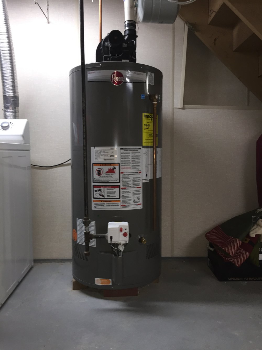 New hot water heater installation, with direct venting, replacing customer's existing unit and removing the need for a chimney flu. Installation and method of venting is more energy efficient and has reduced the customer's energy costs.