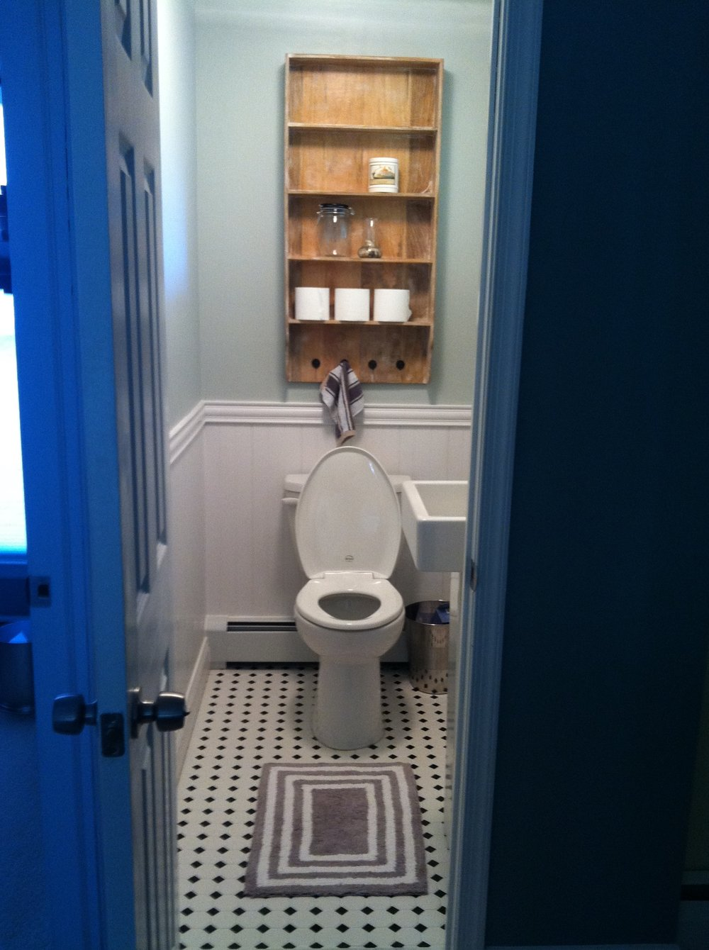 "New bathroom installation, with heating baseboard and custom tile work added. The customer now has a custom powder room that is not longer a ""cold zone"" in the winter."