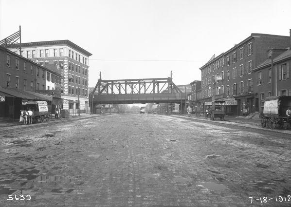 A view of Spring Garden Street facing East circa 1912. The Reading Viaduct straight ahead and 915 Spring Garden is shown on the left.