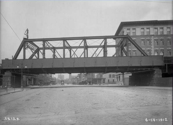 The Reading Viaduct facing West on Spring Garden Street, 915 peeking out from behind the trestle.