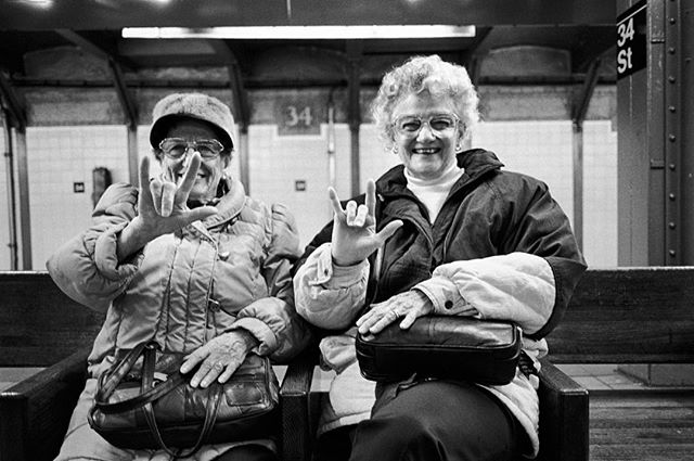 "Join us in Sicily as we celebrate the lives of women of different ages, backgrounds, and experiences. Applications open for just a few more days (link in profile). 📷 These girlfriends, hearing impaired, signed ""I love you,"" as they waited for a train in the subway. New York City, New York, 1993 ©DF #sacredeye #photoworkshop #women"