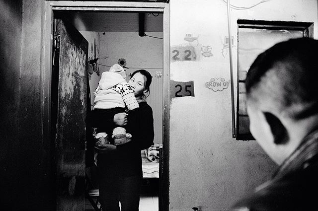 Zhang Ming and her baby boy at the entrance to her home. 📷 Laure de Klopstein @lauredeklopstein 1 of our 5 female photographers. This image is part of a series about the life of a young domestic worker in Shanghai originally from rural Anhui province. #sacredeye