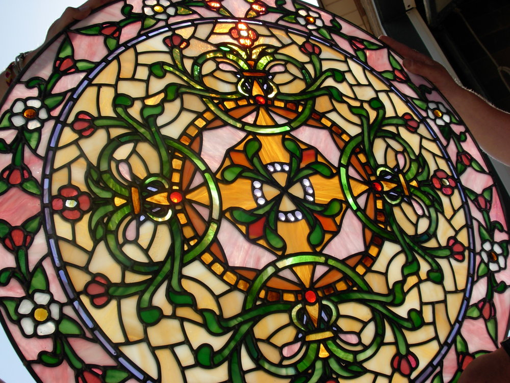 We build stained glass in any shape and size, blending natural stained glass with painted glass, in beautiful color pallets.