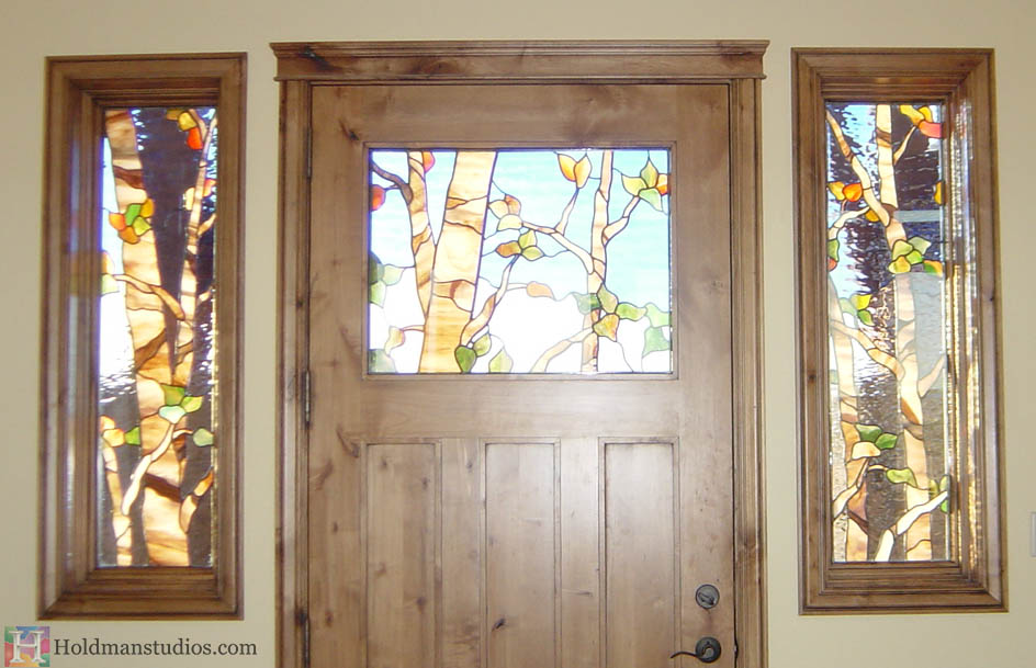 Holdman Studios stained glass front door sidelight windows aspen trees leaves