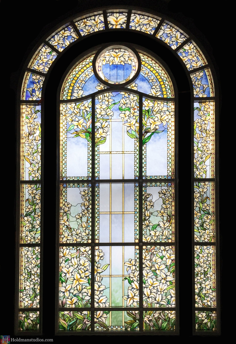 Holdman-Studios-Paris-LDS-Temple-Stained-Glass-Madonna-Lily-Flowers-Leaves-Sun-Moon-Stars-Full-Window.jpg