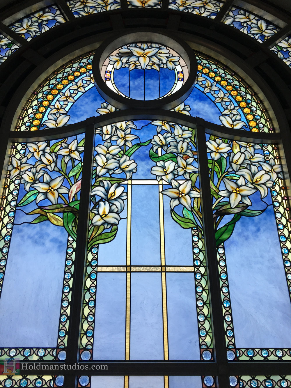 Holdman-Studios-Paris-LDS-Temple-Stained-Glass-Madonna-Lily-Flowers-Leaves-Sun-Moon-Stars-Window.jpg